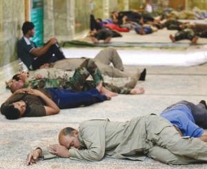 Shi'ites volunteers in support of the Iraqi Army sleep inside the Imam al-Askari shrine in Samarra
