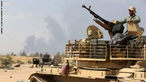 An Iraqi army member mans a tank on the outskirts of Baiji refinery north of Tikrit, during a joint operation between the army and popular mobilisation units to retake the remaining area of the Baiji oil refinery from Islamic State (IS) group jihadists, on May 24, 2015. The Islamic State group has executed 16 Iraqi traders taking food from the city of Baiji to the government-controlled western city of Haditha, officials said. AFP PHOTO / AHMAD AL-RUBAYE        (Photo credit should read AHMAD AL-RUBAYE/AFP/Getty Images)