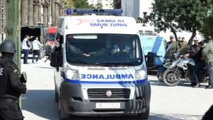 Tunisian security forces open a gate to allow an ambulance carrying wounded victims from a gunmen attack at Tunis' famed Bardo Museum on March 18, 2015 to pass. At least 17 foreigners were killed, they were among 19 people who died in the attack by two men armed with assault rifles on the museum, the interior ministry said. The attack appeared to be the worst on foreigners in Tunisia since an Al-Qaeda suicide bombing on a synagogue killed 14 Germans, two French and five Tunisians on the island of Djerba in 2002. AFP PHOTO / FETHI BELAID        (Photo credit should read FETHI BELAID/AFP/Getty Images)
