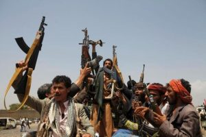 Houthi fighters react while riding on the back of a truck as they attend a tribal gathering in Yemen's capital Sanaa, August 11, 2016. REUTERS/Mohamed al-Sayaghi