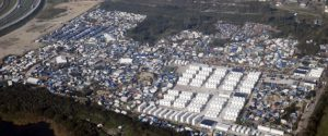 """An aerial view shows white containters, tents and makeshift shelters on the eve of the evacuation and dismantlement of the camp called the """"Jungle"""" in Calais, France, October 23, 2016.    REUTERS/Pascal Rossignol"""