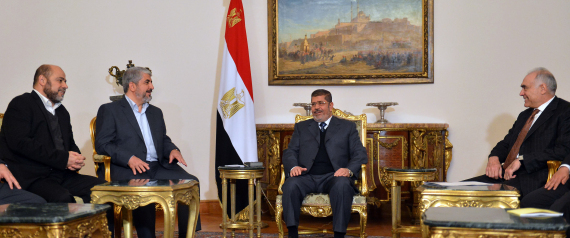 Egyptian President Mohamed Morsi (C) and his Foreign Minister Mohamed Kamel Amr (R) meet with Hamas leader Khaled Meshaal (2-L) and Hamas political bureau member Musa Abu Marzuk (L) in Cairo on January 9, 2013. Palestinian leaders Mahmud Abbas and Khaled Meshaal are due to hold talks in Cairo on a stalled reconciliation agreement, and separately meet with Egyptian President Mohamed Morsi, officials said.  AFP PHOTO / KHALED DESOUKI        (Photo credit should read KHALED DESOUKI/AFP/Getty Images)