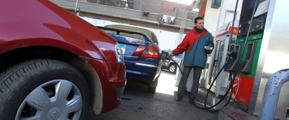 An Egyptian worker fills a customer's car tank at a petrol station in Cairo on January 16, 2012 amid fears of an oil shortage. AFP PHOTO / KHALED DESOUKI (Photo credit should read KHALED DESOUKI/AFP/Getty Images)