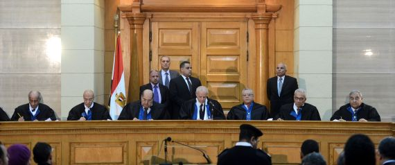 """Members of Egypt's constitutional court hold a session to rule on the law organising the upcoming parliamentary elections on March 1, 2015 in the capital Cairo. The administrative court, which rules on state related matters, ruled that parts of the law organising parliamentary elections starting March 21 violate the charter. President Abdel Fattah al-Sisi ordered that the law be redrafted within a month and asked that """"legal measures be undertaken to avoid delaying"""" the election, his office said. AFP PHOTO/ MOHAMED EL-SHAHED        (Photo credit should read MOHAMED EL-SHAHED/AFP/Getty Images)"""