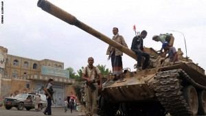 Fighters loyal to Yemen's exiled President Abedrabbo Mansour Hadi stand guard outside the gate leading to the governorate building in Yemen's third city Taez, after they seized it from rebel fighters on August 18, 2015. Pro-government and rebel forces have for months fought over Taez, seen as crucial gateway to the rebel-held capital Sanaa. AFP PHOTO / AHMAD AL-BASHA        (Photo credit should read AHMAD AL-BASHA/AFP/Getty Images)