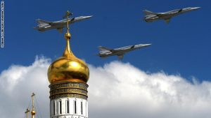 Russian Tupolev Tu-22M supersonic strategic bombers fly above the Kremlin's cathedrals in Moscow, on May 5, 2015, during a rehearsal of the Victory Day parade. Russia will celebrate the 70th anniversary of the 1945 defeat of Nazi Germany on May 9. AFP PHOTO / VASILY MAXIMOV        (Photo credit should read VASILY MAXIMOV/AFP/Getty Images)