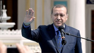 Turkey's President Recep Tayyip Erdogan waves as he inaugurates the Diyanet Islamic Cultural Center in Lanham, Maryland on April 2, 2016.  / AFP / Olivier Douliery        (Photo credit should read OLIVIER DOULIERY/AFP/Getty Images)