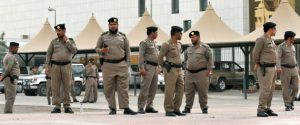 """Saudi policemen stand guard in front of the """"Public grievances Department"""" building in Riyadh on March 11, 2011 as Saudi Arabia launched a massive security operation in a menacing show of force to deter protesters from a planned """"Day of Rage"""" to press for democratic reform in the kingdom.   AFP PHOTO/FAYEZ NURELDINE (Photo credit should read FAYEZ NURELDINE/AFP/Getty Images)"""