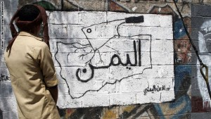"""A Yemeni man looks at graffiti on a wall reading in Arabic: """"Yemen"""" on October 16, 2014 in the capital Sanaa. Suspected al-Qaeda militants have seized control of a town in southwest Yemen, hours after Shiite rebels overran a nearby provincial capital, a security official said on October 15, 2014.  AFP PHOTO / MOHAMMED HUWAIS        (Photo credit should read MOHAMMED HUWAIS/AFP/Getty Images)"""